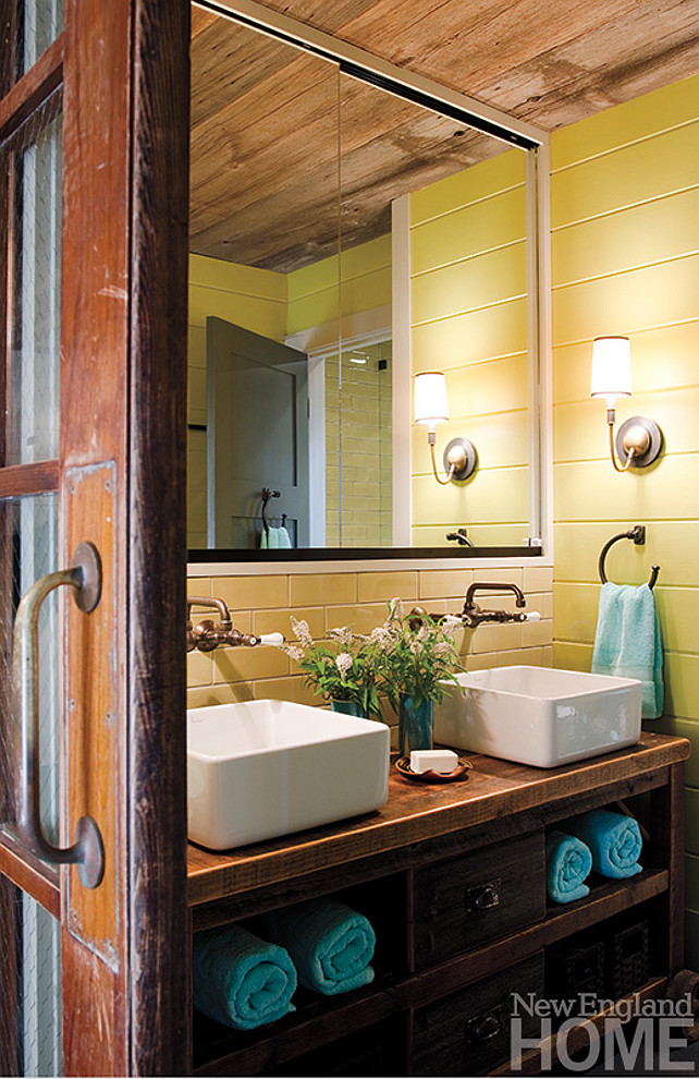 Reclaimed Wood. Bathroom Reclaimed Wood Ideas. The kids' bathroom closes with a sliding barn door outfitted with glass panes that sandwich chicken wire. #Bathroom #ReclaimedWood