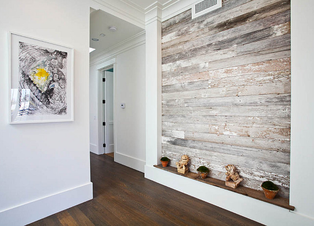 Reclaimed wood. Reclaimed wood plank wall. Foyer with reclaimed wood plank wall.