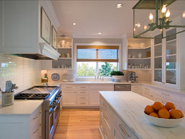 The countertops at the perimeter cabinets are Pental Quartz Lattice BQ8220. The island countertop is Valley Gold Calacatta marble. #Countertop #Marble