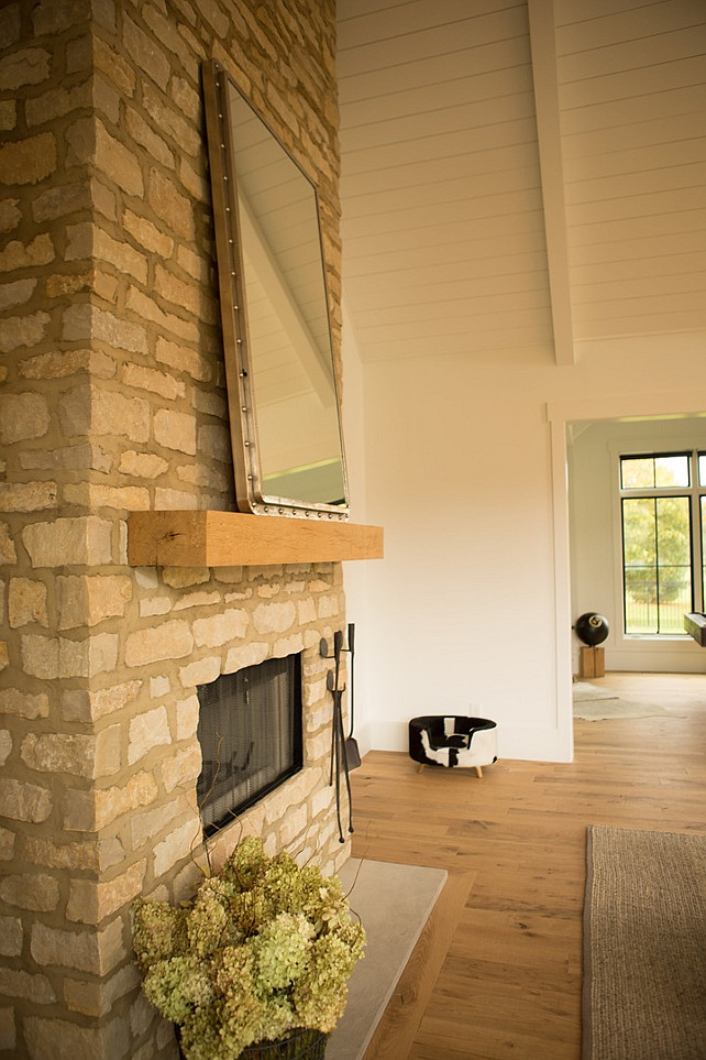 Rustic Stone Fireplace with timber mantel. Floor-to-ceiling Rustic Stone Fireplace with timber mantel. #Fireplace #Rustic #Stone #Timber #Mantel Hahn Builders.