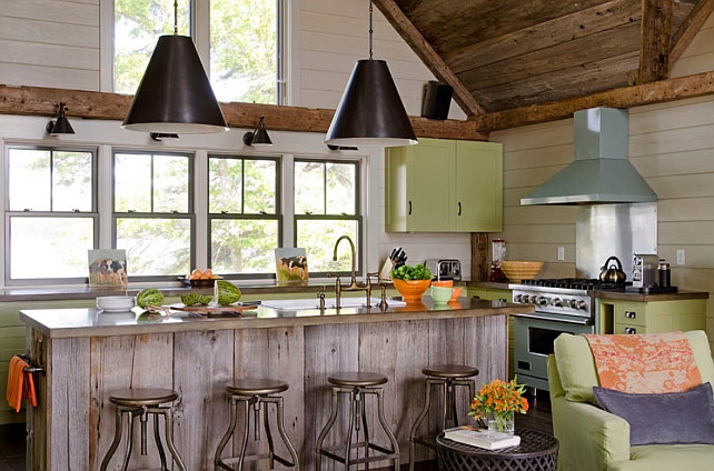 Rustic kitchen with a modern feel. Rustic kitchen with a modern feel. Rustic kitchen with rustic wood ceiling and plank island with modern elements. #Kitchen #RusticInteriors #ModernKitchen #RusticKitchen OLSON LEWIS + Architects. This rustic kitchen features reclaimed barn board planked cathedral ceiling over a barn board kitchen island with farm sink and gooseneck faucet. The island features industrial backless counter stools illuminated by a pair of Goodman Hanging Lamps in Antique Nickel. The green cabinets are painted in Valspar La Fonda Olive and are accented with oil-rubbed bronze cup pull hardware. Rustic kitchen with rustic wood ceiling and plank island with modern elements. #Kitchen #RusticInteriors #ModernKitchen #RusticKitchen OLSON LEWIS + Architects.