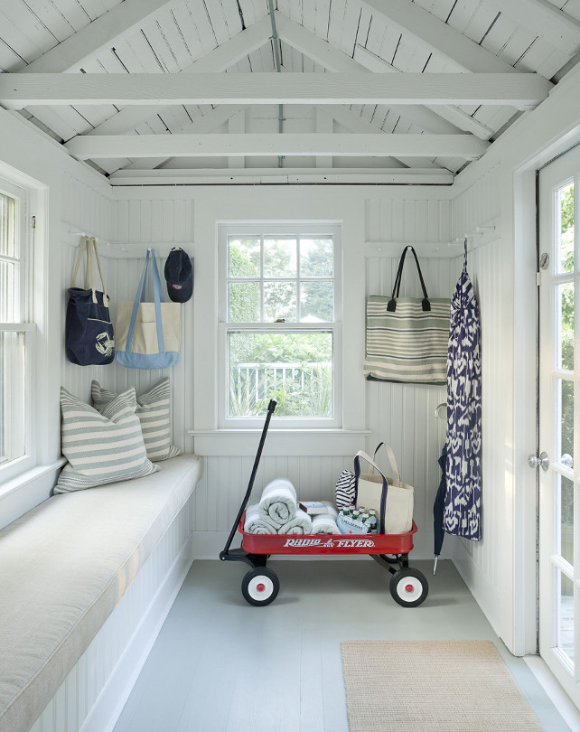 Shed Interior Ideas. This backyard shed is used as a playroom - play area for the kids. The playroom features painted wooden floors and a window seat. #Playroom #Playarea #shed Emily Gilbert Photography.