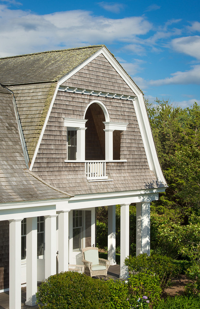Shingle Gambrel Home. Balcony. Beach house. Shingle Cape cod. Cedar shake. Cedar siding. Colums. Gambrel roof. Martha's vineyard. Massachusettes. New England. Ocean. Porch. Shake roof. Shakes. Shingle. Summer house. Vacation house. Waterfront. Wood exterior. Wrap around porch.