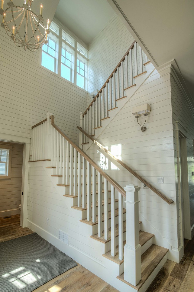 Shiplap Foyer. Shiplap foyer staircase. Shiplap foyer ideas. Beach house with shiplap foyer and wrapround staircase. #Foyer #Shiplap  Christ & Associates.