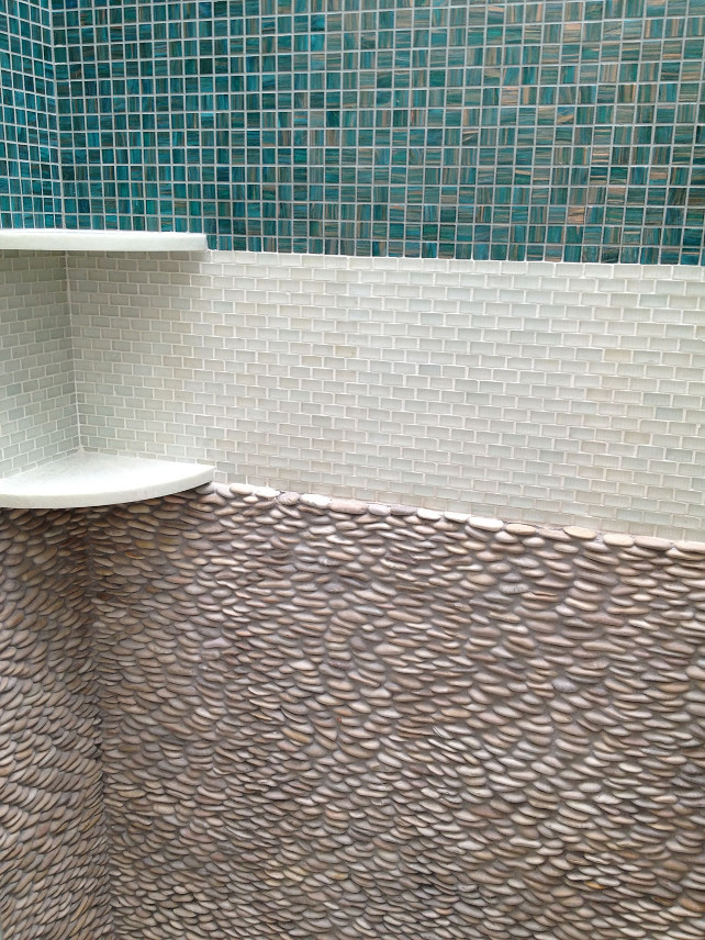 Shower Tiling. Coastal Shower Tiling. This open, coastal shower boasts a beautiful three-tile wall with turquoise, white, and then stone tiling. #Shower #Tiling #ShowerTiling #Coastal #OpenShower #Bathroom
