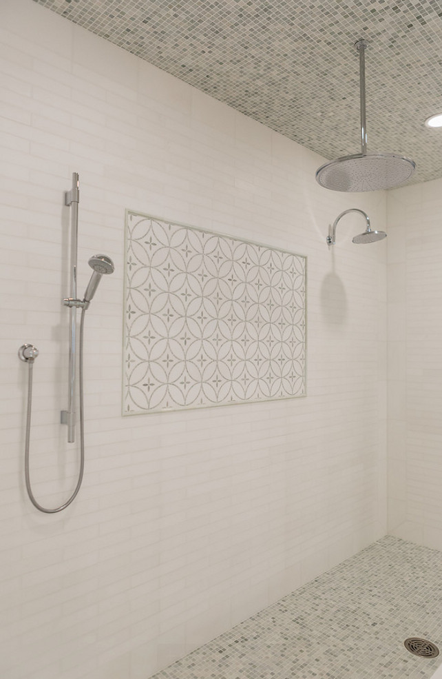Shower Tiling. Shower Tiling and Flooring. Shower Tiling and Flooring Combination. The shower features white linear tile surround accented with decorative inset tiles and mosaic marble tile on ceiling and floor. #ShowerTiling #ShowerFlooring #Tiling #Flooring Brookes and Hill Custom Builders.