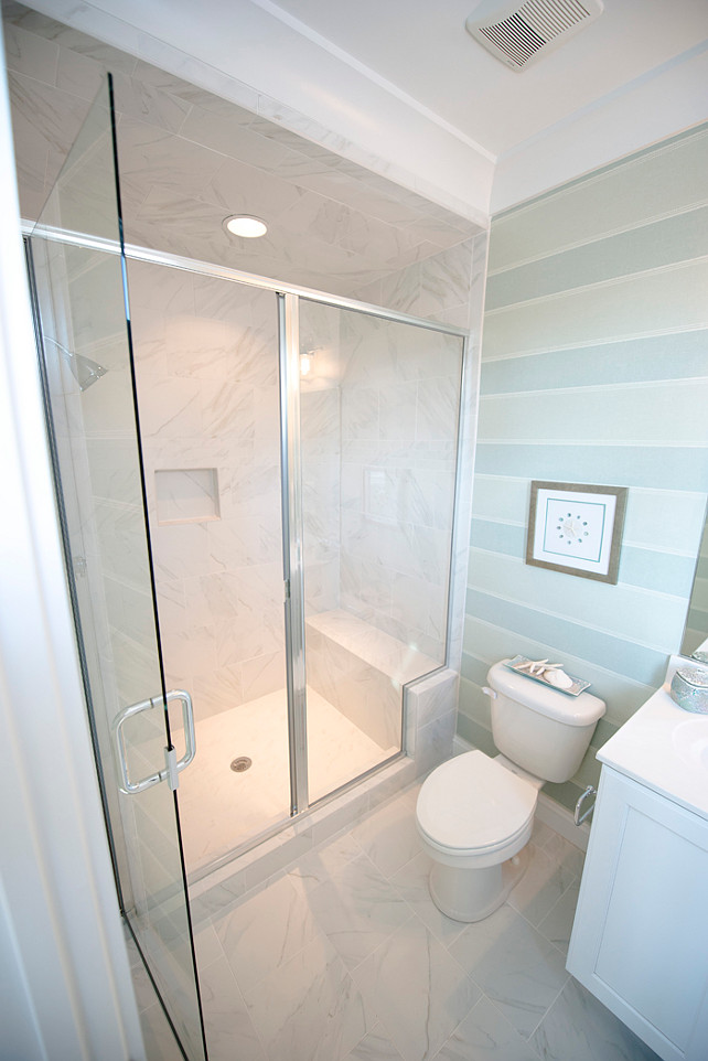 Small Bathroom Layout. How to design a small bathroom layout without making it appear claustrophobic. This is a good example of small bathroom layout. Notice that the shower even features a seating area. #SamllBathroom #SmallSpaces #SmallInteriors
