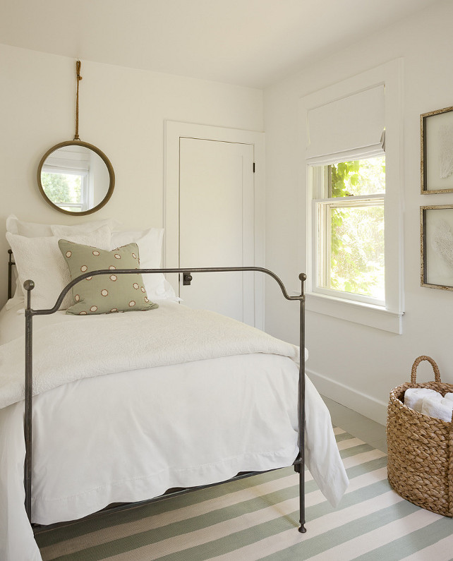 Small Bedroom Design. Small Bedroom Decor. How to design a small bedroom to make it appear bigger. I simply adore this bedroom. Isn't it great? What a calming, serene color palette. The bedroom boasts a vintage mirror hanging over twin metal bed dressed in soft white bedding atop an ivory and mint green striped rug. #SmallBedroom Jenny Wolf Interiors.
