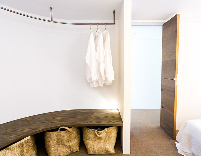 Small Space Solutions. Hanging Rod. Hanging coats hangers attached to the ceiling are a fantastic way of storing clothes without the need for a wardrobe. #SmallSpaceSolutions C+M Studio