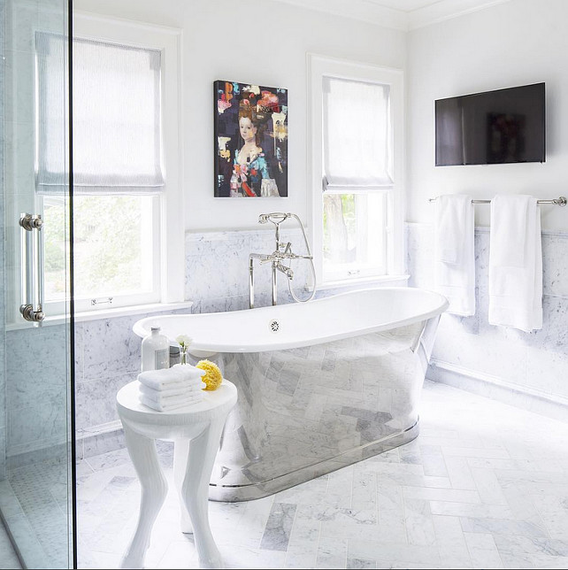 "Bathroom wall tiling and Soaking Bath. Bathroom with Soaking Bath and gray and white herringbone flooring. Bathroom wall tiling is 12"" x 24"" Honed Carrara Marble. #bathroom #SoakingBath Martha O'Hara Interiors."