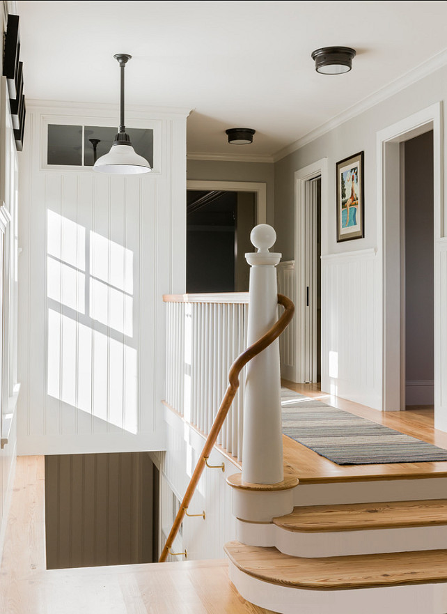Staircase Ideas. Beautiful classic staircase. Coastal and classic, this staircase has a stunning custom bannister and railing. Coastal-inspired lighting is by Visual Lighting. #Staircase #StaircaseStyles #StaircaseDesign