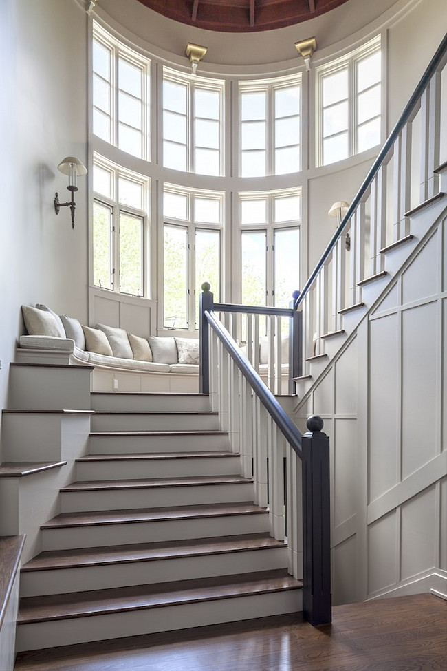 Stairway Bench. Stairway Window Bench. Stairway window seat Bench. Grand stairway with bench under wall of windows. #Stairway #Bench #Windowseat Via Christies Real Estate