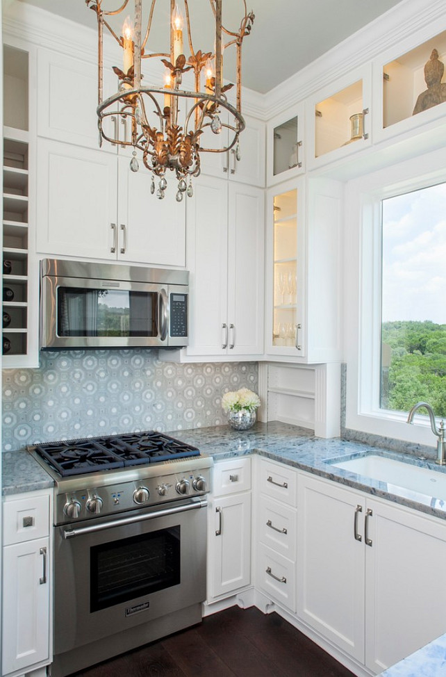 Stone Backsplash. Kitchen Stone Backsplash. The backsplash is a glass and stone pattern by Artistic Tile. #Backsplash #StoneBacksplash Bravo Interior Design.