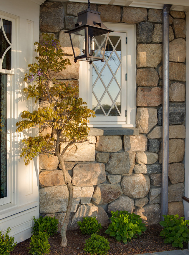 Stone Home Exterior Ideas. Rounded granite fieldstones Significant Homes LLC