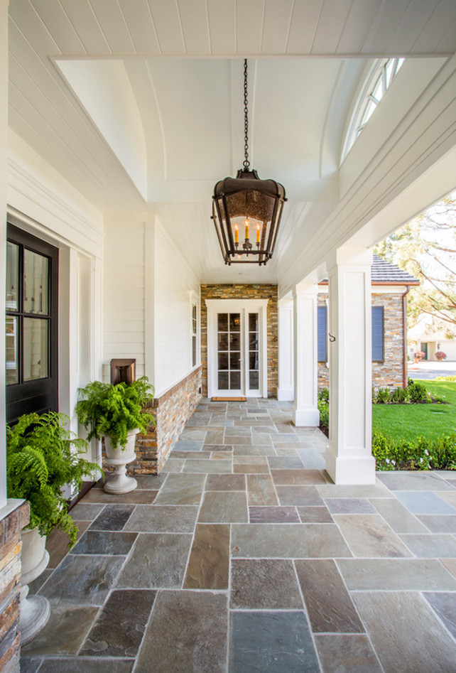 Stone Home Exterior with white siding and stone porch flooring. Stone Home Exterior. #Porch #Stone #Exterior #Homeexterior Legacy Custom Homes, Inc.