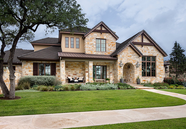 Stone home exterior. Stone home exterior ideas. Natural Stone home exterior. The exterior features natural stone. Flagstone home exterior. Martha O'Hara Interiors.