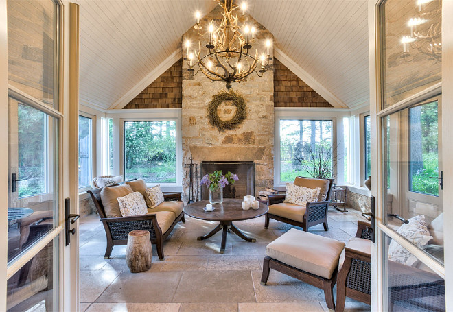 Sunroom. Cathedral Ceiling Sunroom. This sunroom features cathedral ceiling and a stone fireplace. #Sunroom #CathedralCeiling #Stone #Fireplace Sotheby's Homes Canada.