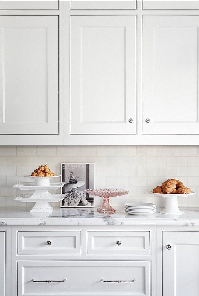 Backsplash Ideas. The backsplash in this kitchen is classic white subway tiles and white marble for the countertop. #Backsplash #Kitchen #ClassicSubwayTile #WhiteMarble #Kitchen