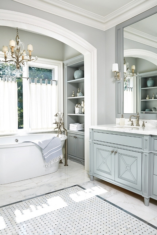 Traditional Bathroom. Traditional Bathroom with blue gray cabinet, gray walls, marble flooring and alcove bath. #TraditionalBathroom Anne Hepfer Designs.