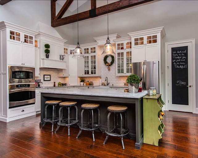 Transitional Kitchen Design. Transitional kitchen with beamed ceiling, hardwood floors, large kitchen island and chalk board paint. #Kitchen #TransitionalKitchen Tolaris Homes.