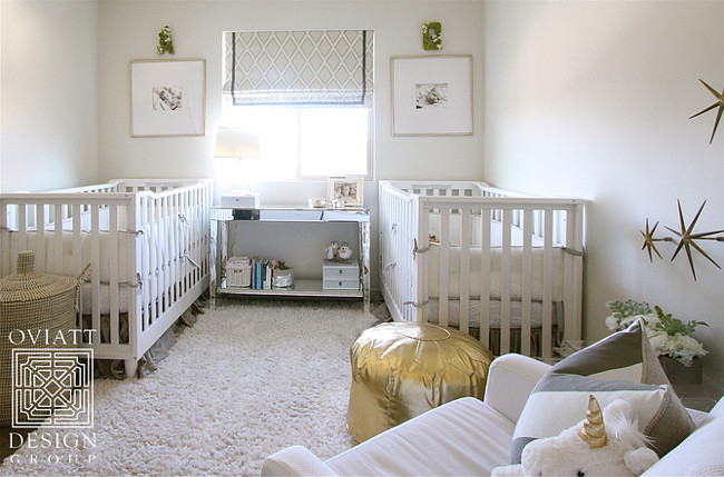 Twin Nursery. Neutral gender twin nursery. Neutral gender twin nursery with gray, white and gold decor. #nursery #twin #TwinNursery #NeutraLgengerNursery Oviatt Design Group.
