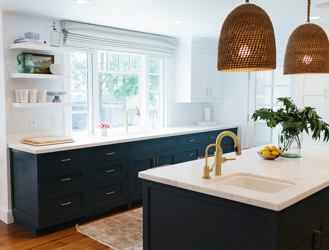 Two toned kitchen. Two toned kitchen painted in white and navy. Two toned kitchen with white upper cabinets and navy lower cabinets. #Twotonedkitchen #cabinets Studio McGee.