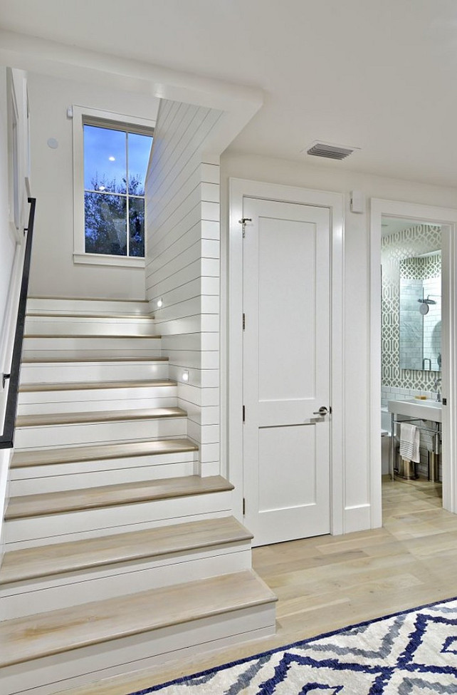 Under stairs Room Ideas. A closet and Powder room is located under the stairs. Redbud Custom Homes.