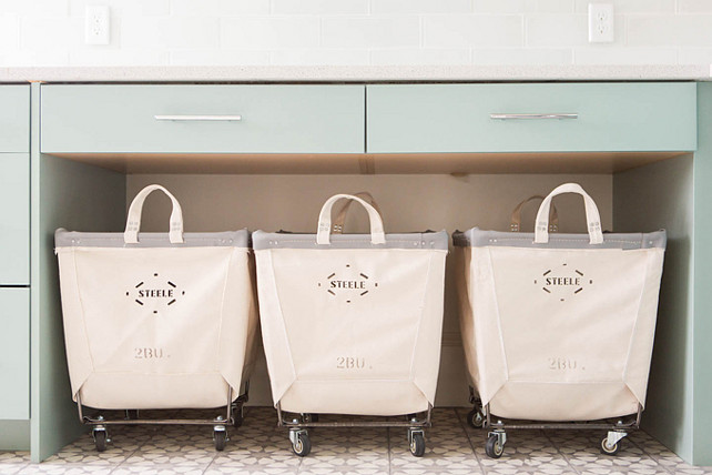 Vintage Rolling Laundry room Carts. Steele Canvas laundry carts. Laundry room with three Steele Canvas laundry carts tucked below a countertop. #LaundryRoom #SteeleCanvaslaundrycart   Ashley Winn Design.