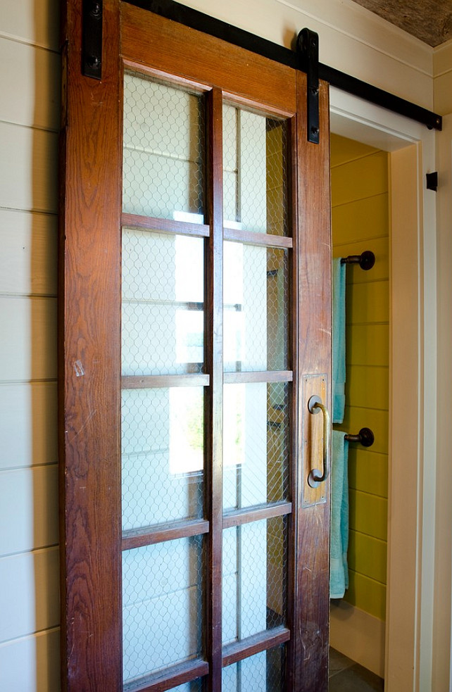 Vintage Sliding Barn Door with vintage door hardware. The sliding door is vintage and chicken wire was added to deliver some character. The designer got it at Old House Parts in Kennebunk Maine. #Vintage #Door #SlidingDoor Kristina Crestin Design.