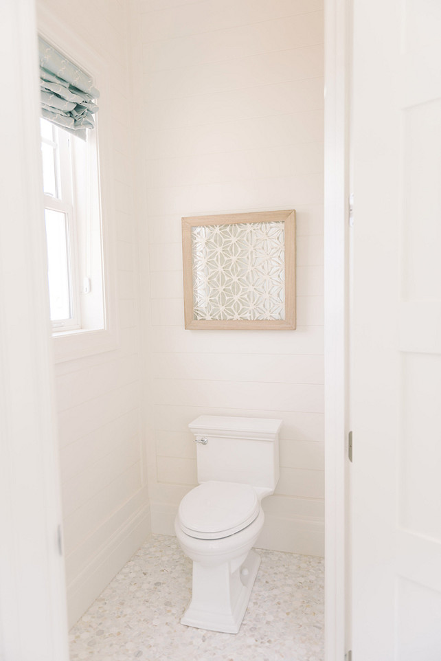 Water Closet with shiplap walls. Four Chairs Furniture.