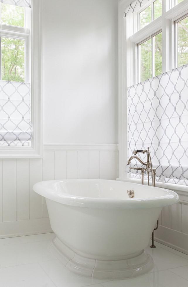 White Bathroom Flooring. White Bathroom with freestanding bath. White Bathroom with Roman shades. #Bathroom #WhiteBathroom Duneier Design.