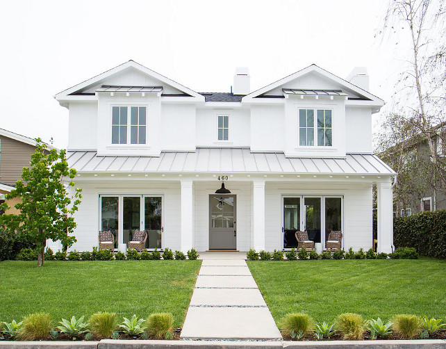 White Exterior Paint Color. White Home Exterior Paint Color Ideas. White Home Exterior. Classic White Home Exterior with Gray Front Door and Metal Roof. #WhiteHomeExterior Graystone Custom Builders.