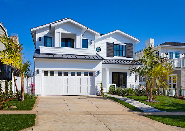 White Exterior Paint Color. White exterior paint color ideas. White exterior with charcoal metal roof and charcoal window shutters. White Picket Fence, Inc.