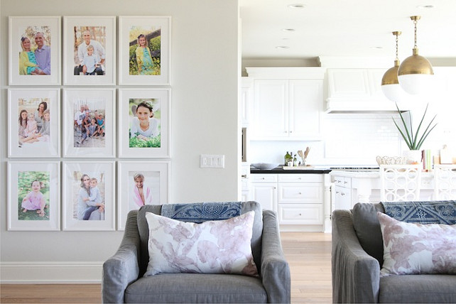 White Gallery Picture Wall. Home project featuring a white gallery wall filled with family photos. Becki Owens.