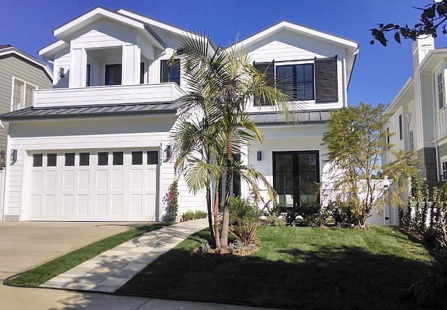 White Home Exterior Ideas. Modern White Home Exterior with Dark Gray (Charcoal) Shutters. #WhiteExterior #WhiteHouseExterior #WhiteHomeExterior #Shuuters #DarkrGray #CharcoalShutters White Picket Fence, Inc.
