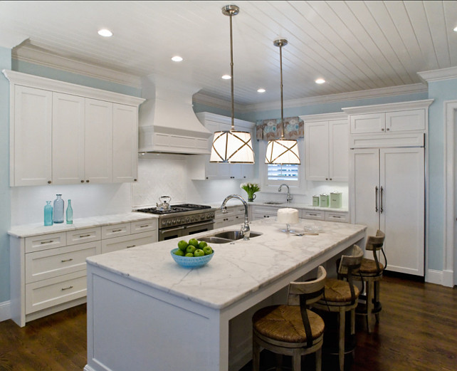 Design White Kitchen with white marble countertop and turquoise