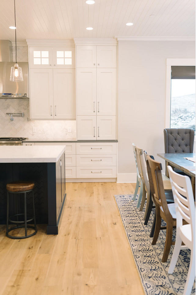 White Kitchen with Wide Plank Floors. White Kitchen wide plank hardwood flooring. #KitchenWideplankHardwood #KitchenWideplankHardwoodFlooring  #WhiteKitchenWideplankHardwood Four Chairs Furniture.