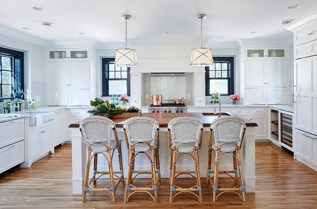 White Kitchen. Kitchen with white cabinet, Serena & Lily Riviera Counter Stool, Grosvenor One-Light Downlight by Sandy Chapman pendant lighting above island, walnut kitchen countertop and Roman granite perimeter countertop. #kitchen Kitchen design by Martha O'Hara Interiors.