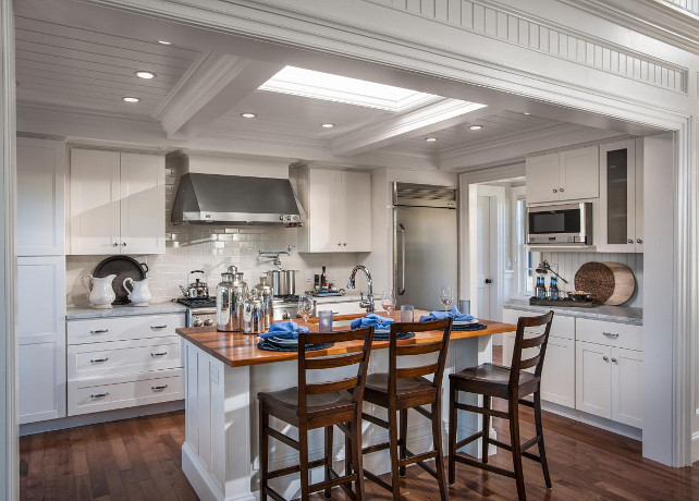 White Kitchen. Classic white kitchen with beamed ceiling, skylight, crisp white cabinets, wood floors and custom kitchen island. #Kitchen #WhiteKitchen #HGTV2015DreamHouse