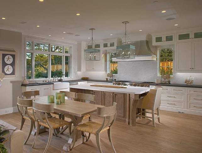 White Kitchen. Gorgeous white kitchen with Urban Electric Co. Michael Amato Chisholm Hall Pendants, white kitchen cabinets with marble countertops. #WhiteKitchen #Kitchen #KitchenIdeas #KitchenDesign #KitchenLayout