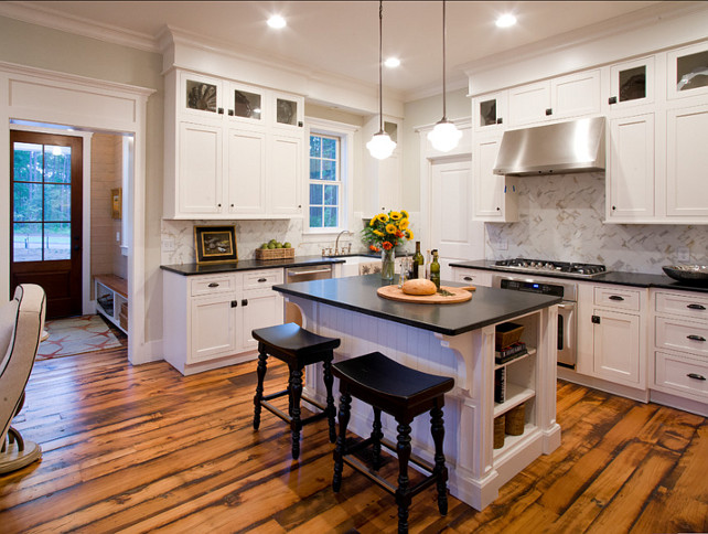 White Kitchen. Inspiring white kitchen with classic cabinets. Pendant Lighting are Hudson Valley Pendants 9413 from Hagemeyer.#WhiteKitchen #Kitchen