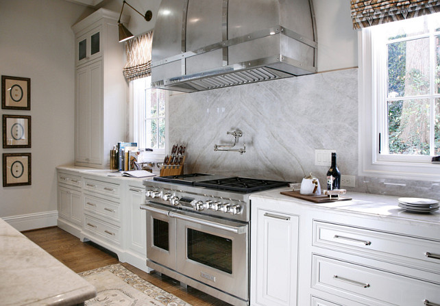 White Kitchen. White Kitchen with quartzite countertop. White Kitchen cabinet and quartzite countertop. #WhiteKitchen #quartziteCountertop Barbara Brown Photography. Bell Kitchen and Bath Studios.