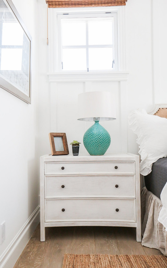 White Nightstand. Coastal bedroom with White Nightstand and turquoise table lamp. #WhiteNightstand #CoastalBedroom #CoastalInteriors #Turquoise #TurquoiseLamp Blackband Design.