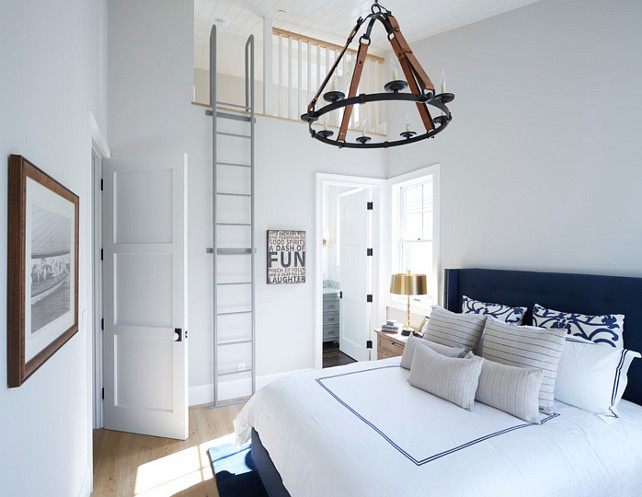 White and navy coastal bedroom. Chandelier is the Suzanne Kasler Dressage Round Ceiling Light.  #WhiteandNavy #Bedroom #Coastal  DTM INTERIORS