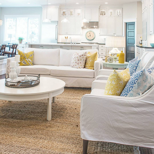 White interiors with pops of color. Beautiful open main floor with white walls, white furniture with pops of color. Lindsay Hill Interiors.