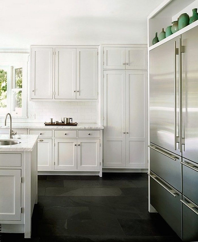 White kitchen Flooring Ideas. White kitchen cabinet with bluestone tile flooring. #Bluestone #KitchenFlooring #TileFlooring #WhiteKitchenFlooring Via Remodelista.