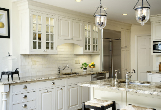 White kitchen cabinets with stainless steel refrigerator. Fivecat Studio.