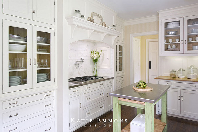 White kitchen with custom cabinets and portable kitchen island. #kitchen #portableisland #portablekitchenisland