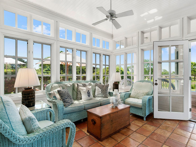 Wicker Furniture. Cottage sunroom with painted antique wicker furniture. The antique wicker furniture is painted in a turquoise paint color and the cushions were done using outdoor fabric. #WickerFurniture #AntiqueWickerFurniture #PaintedWickerFurniture