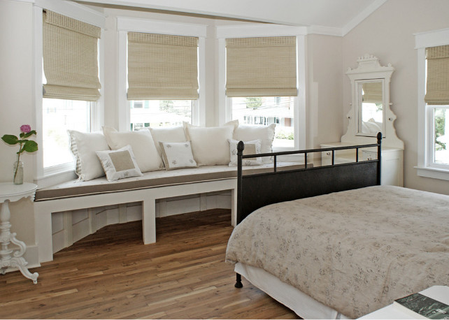 Window seat. Bedroom with window seat. Bedroom window seat fabric. A guest room with a romantic mix of late 19th century Americana and Provencial detailing has a large window seat in the turret that affords expansive views of Beach Haven's most beautiful Victorians down the street. #Bedroom #WindowSeat